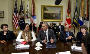 Brittany Packnett sits beside President Obama at the White House to discuss civil rights. Photograph: Carolyn Kaster/AP